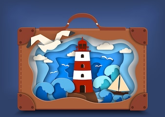 Lighthouse on coast inside brown suitcase