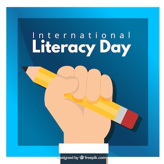 Literacy day background of hand with pencil