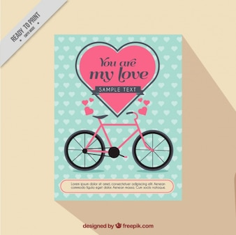 Love card with hearts and pink bicycle