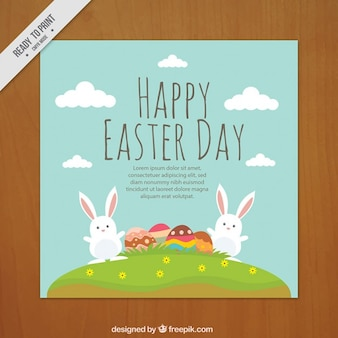 Lovely bunnies with Easter eggs greeting card
