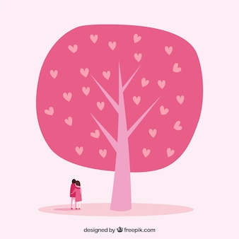 Lovely couple with pink tree of hearts