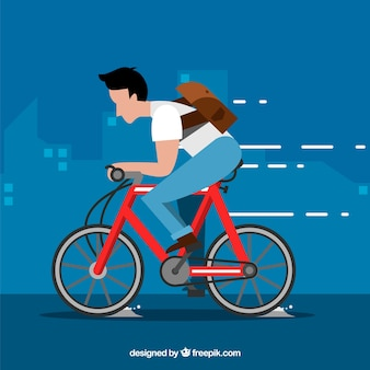 Man riding bike with flat design