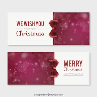 Merry christmas banners with a red bow