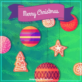 Merry christmas card with watercolor balls and gingerbread cookies