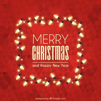 多角形の背景とライトが付いてメリークリスマス