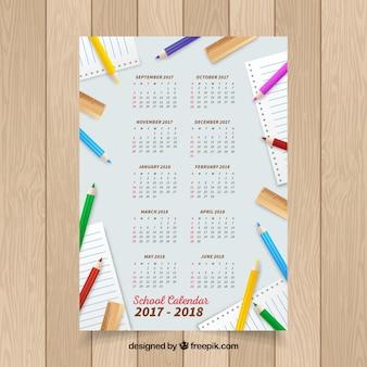 Modern school calendar with colorful pencils