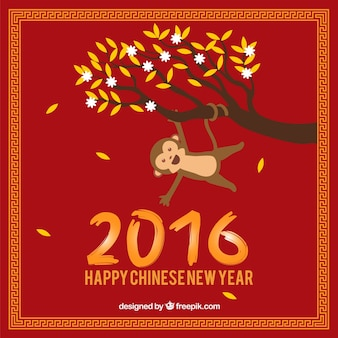 Monkey hanging of the tree branch new year background