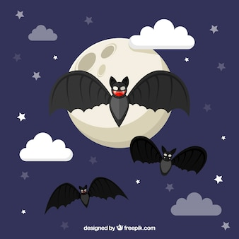Moon background with bats in flat design