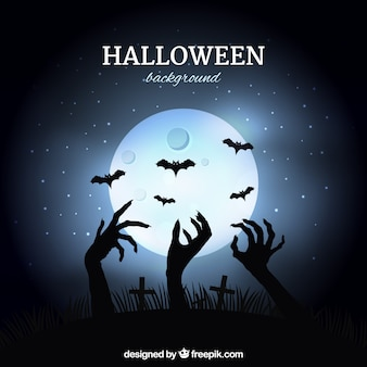 Moon background with zombie hands coming out of the ground