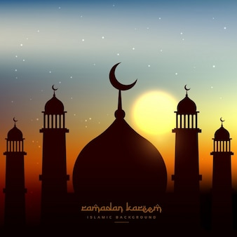 Mosque silhouette in evening sky with sun