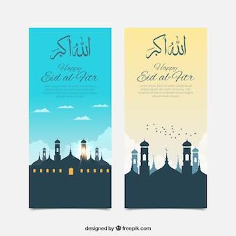 Силуэты мечетей с баннерами