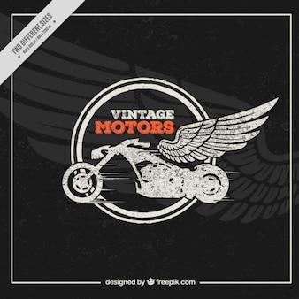 ヴィンテージスタイルで羽の背景とバイク