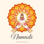 Namaste gesture with colorful mandala