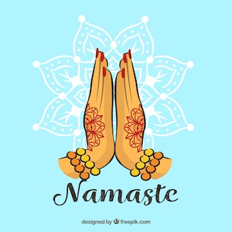 Namaste gesture with henna tattoos