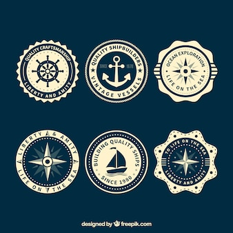 Nautical badges with several decorative elements