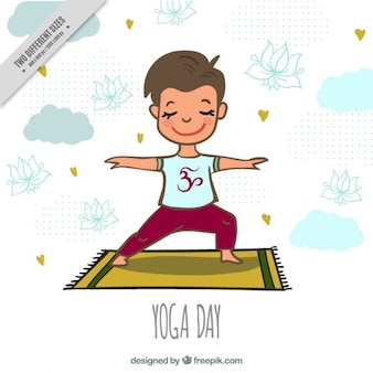 Nice boy doing yoga on a carpet background