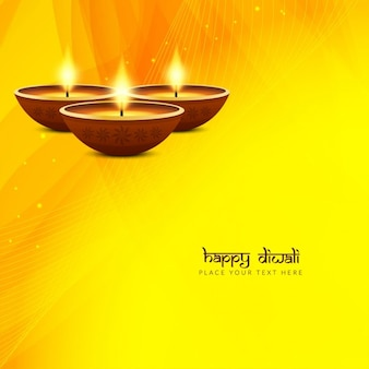 Nice yellow background with three candles, diwali