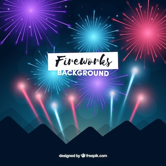 Night background with mountains and fireworks