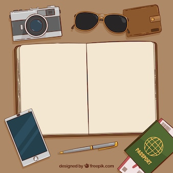 Notebook background with passport and other elements and vintage travel
