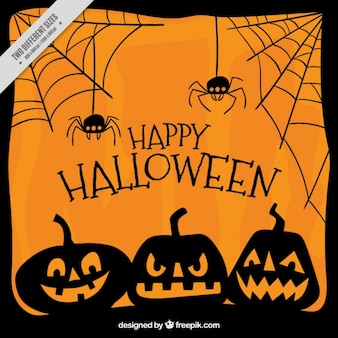 Orange background with pumpkins and spiders