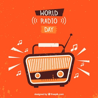 Orange background with vintage radio to celebrate world radio day