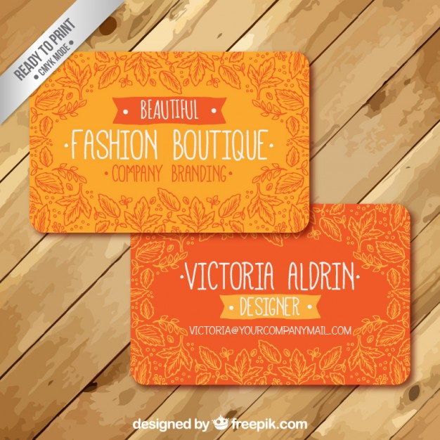Orange business card with leaves