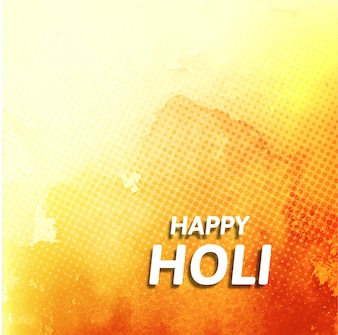 Orange dotted background with watercolors for holi festival