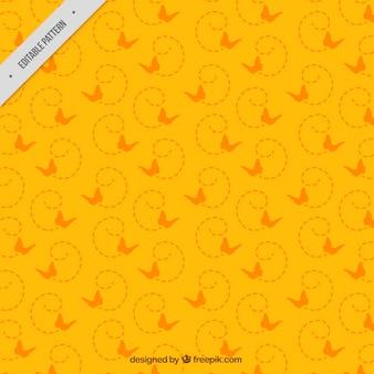 フラットなデザインに飛んで蝶のオレンジパターン