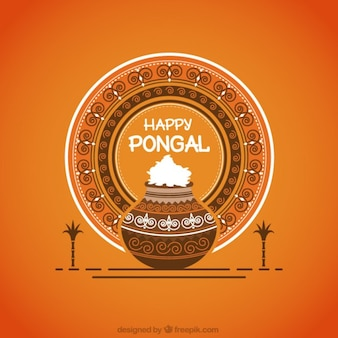 Ornamental pongal rice pot on orange background