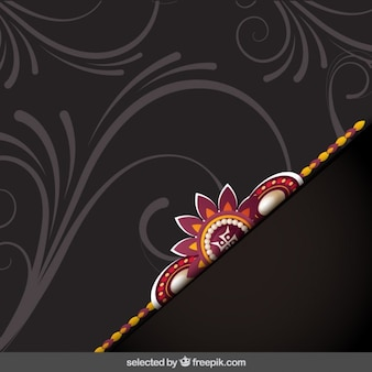 Ornamental Rakhi brown background