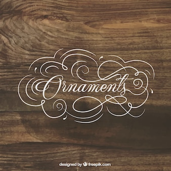 Ornaments lettering on wood background