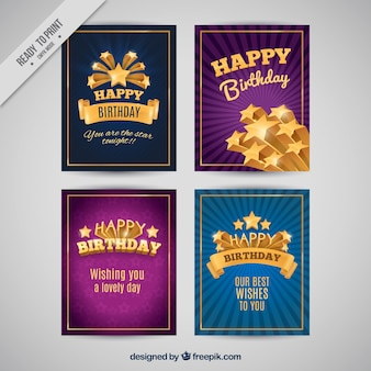 Pack of four birthday cards with golden details