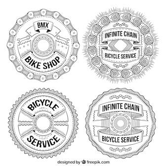 Pack of four circular hand drawn bike badges