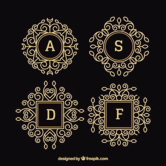 Pack of four gold ornamental monograms