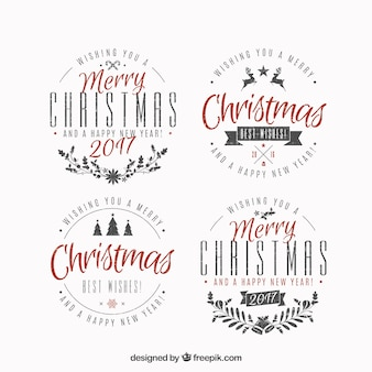 Pack of four merry christmas badges in flat design