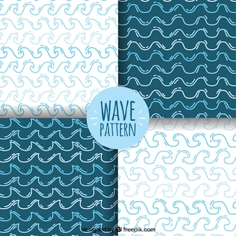 Pack of four patterns with hand-drawn waves