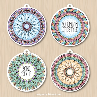 Pack of four round ethnic labels in watercolor design