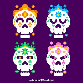 Pack of four skulls with flowers in flat design
