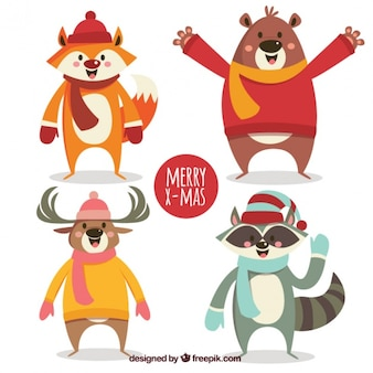 冬のアクセサリーを持つ4つの笑顔の動物のパック