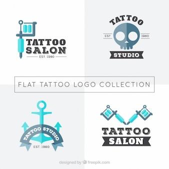Pack of four tattoos studio logotypes in flat design