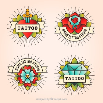 Pack of four vintage tattoo logos in linear style