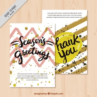 Pack of greeting cards with stains and lines