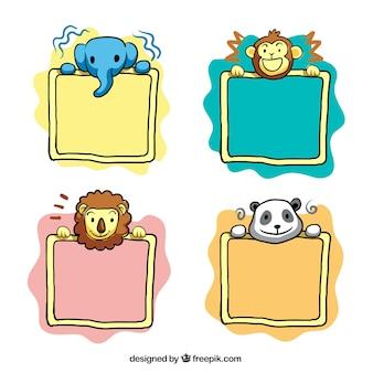 動物との手描きの装飾的なフレームのパック