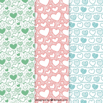 Pack of hand drawn hearts patterns