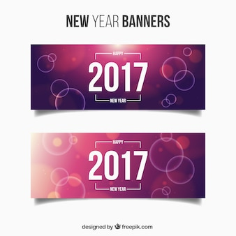 Pack of new year banners with purple backgrounds and bright circles