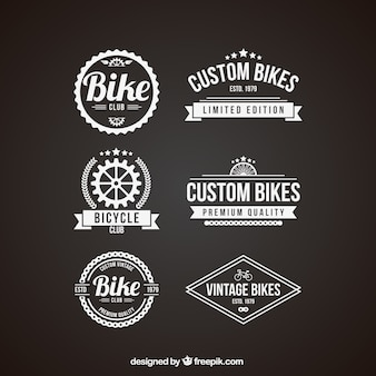 Pack of retro bike badges in white color