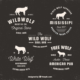 Набор ретро-логотипов с силуэтами волка