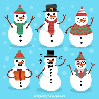 Pack of snowmen with scarfs and hats