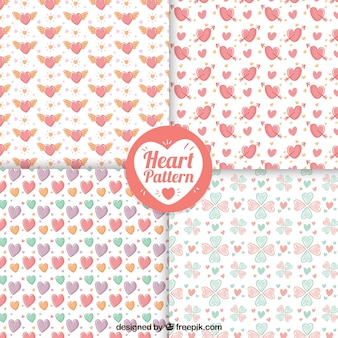 Patterns of hand drawn pretty hearts