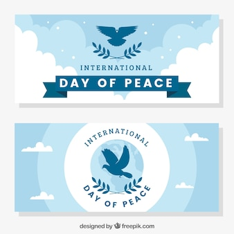 Peace day banners with pigeons silhouette